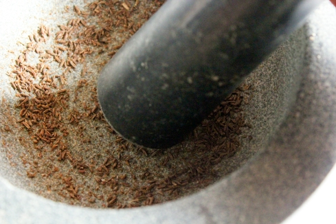 caraway seeds crushed in mortar and pestle